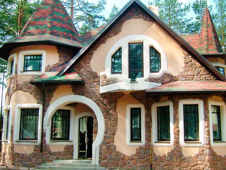 Отделка фасада дома искусственным декоративным камнем